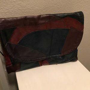 Vintage patchwork leather clutch